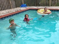 The kids at the beach house pool